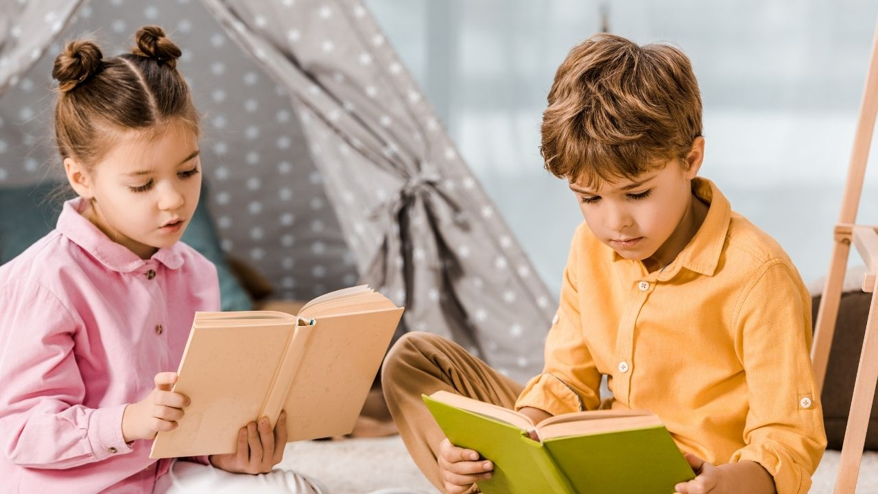 two children reading in a cozy book nook