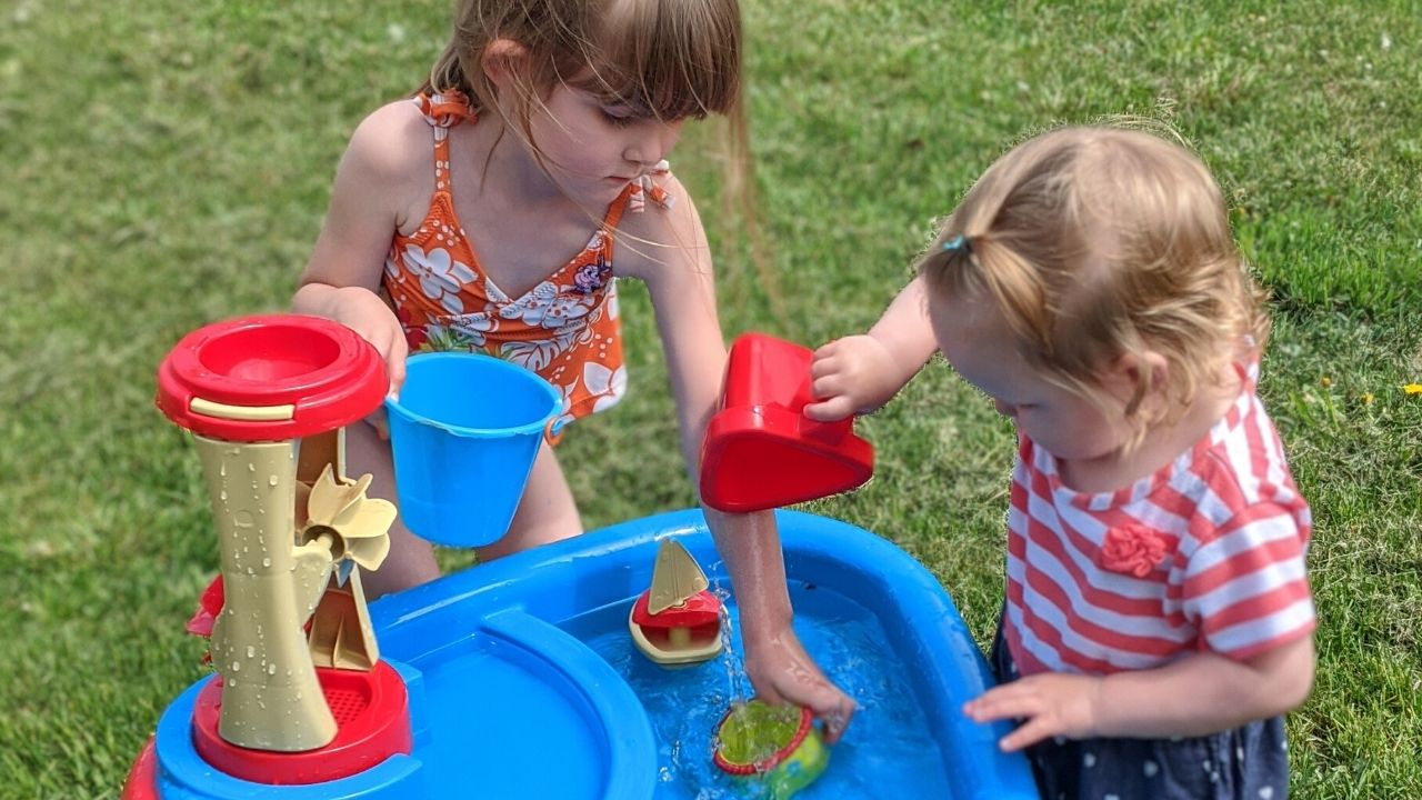 featured photo of toddler and preschooler engaging in play-based educational activities