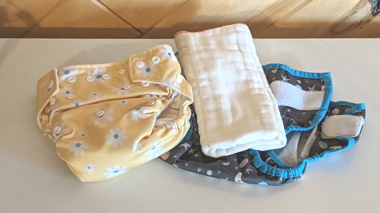 featured photo | pocket diaper and prefold with a cover