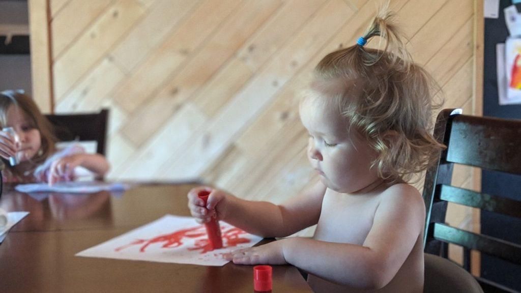 photo of my kids using their tempera paint sticks to create beautiful works of art
