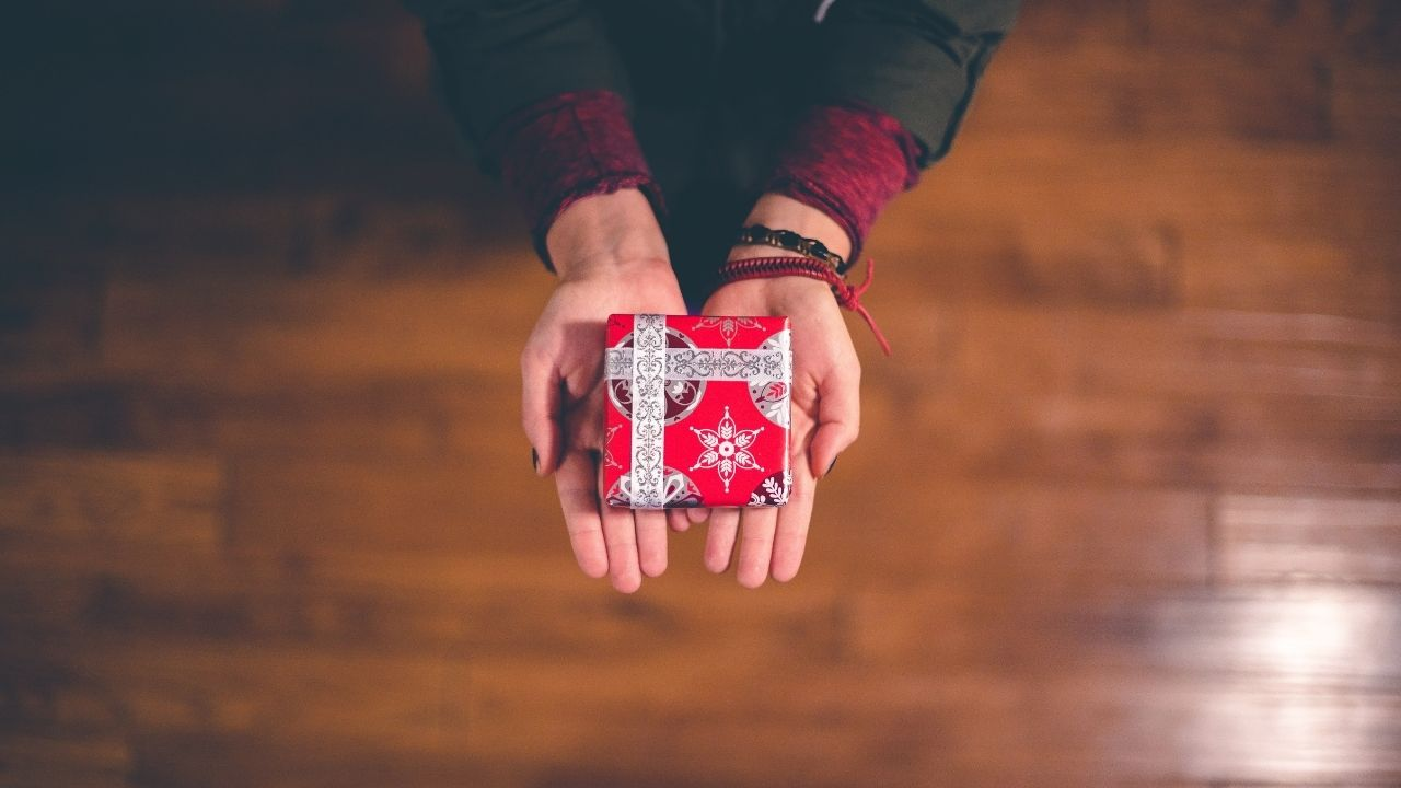 photo of hands holding a small gift