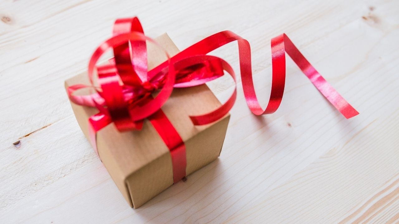 gift wrapped with red ribbon