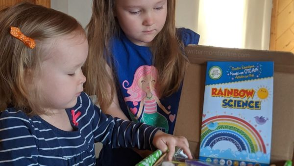 my girls looking at their rainbow science craft box