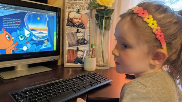 my daughter using the homer reading app on the computer