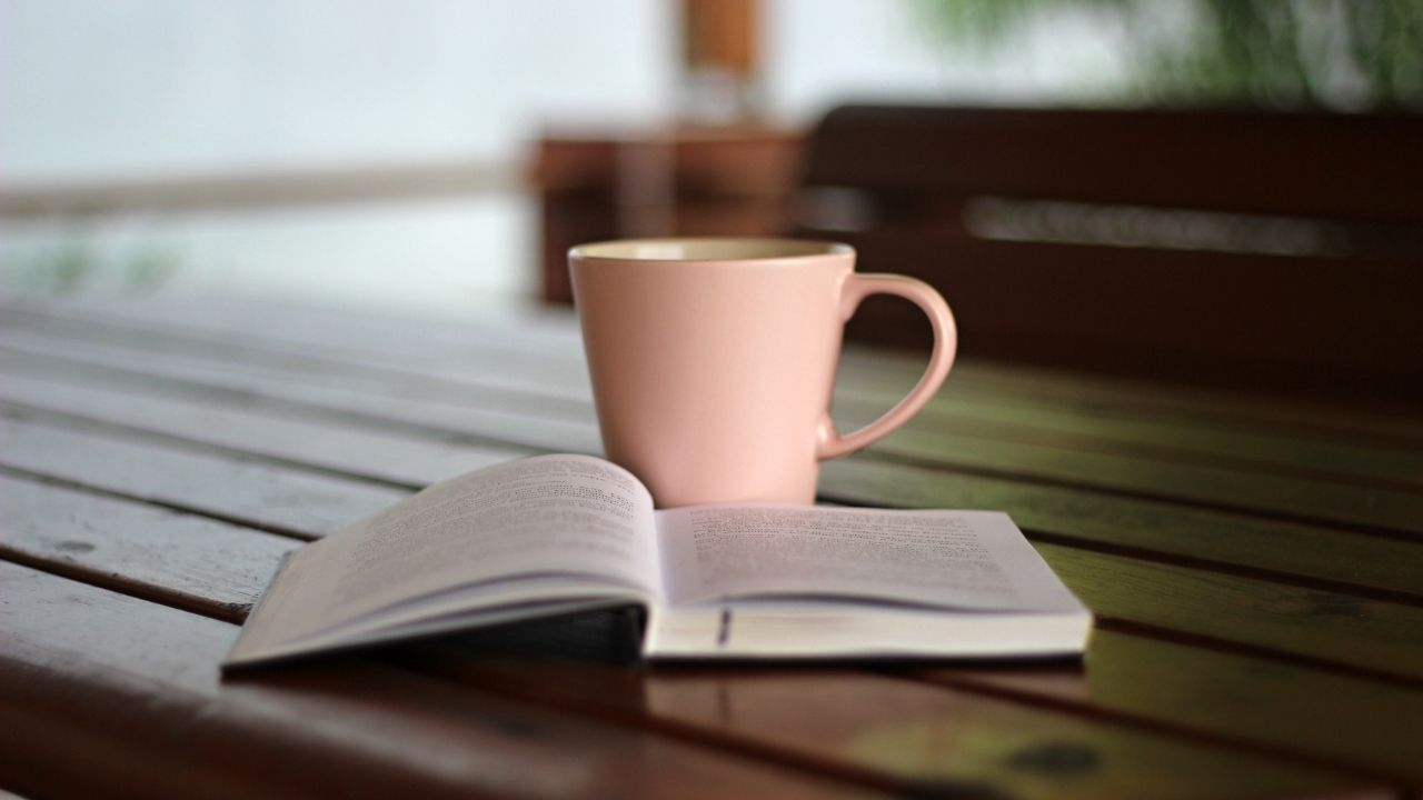 journal and coffee mug