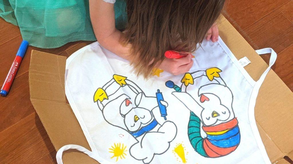 my preschooler coloring her apron