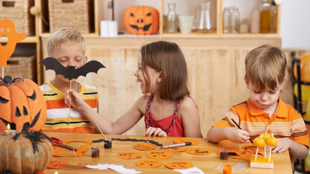 children making halloween crafts