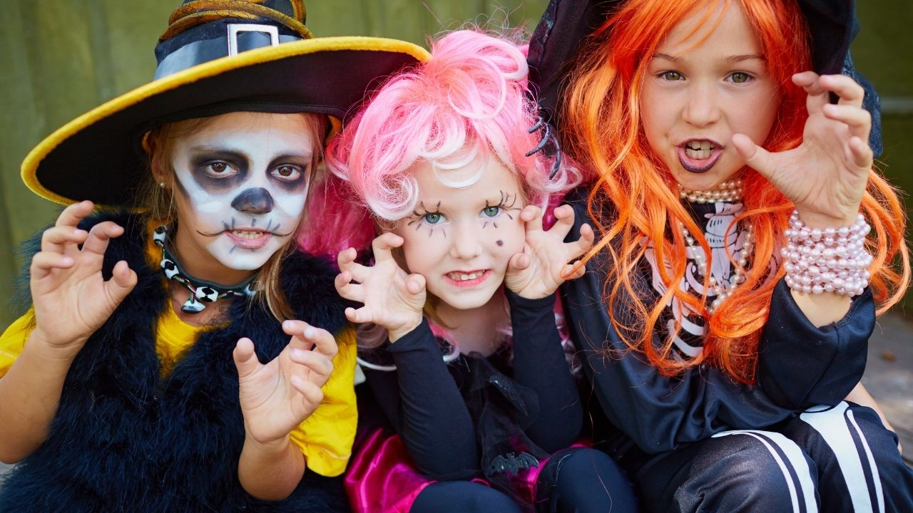 children dressed in halloween costumes - the featured image for the article on games for halloween for preschoolers
