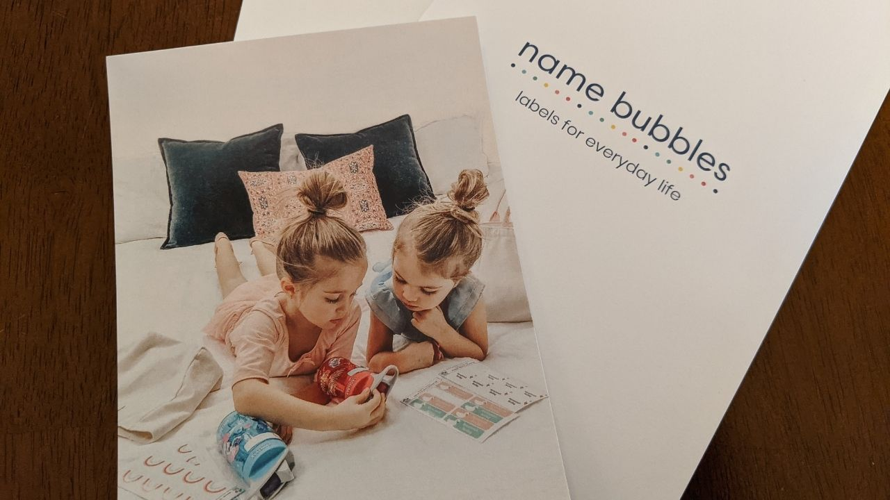 Image of two girls looking at their name labels - How to Get Organized for Back to School With Name Bubbles