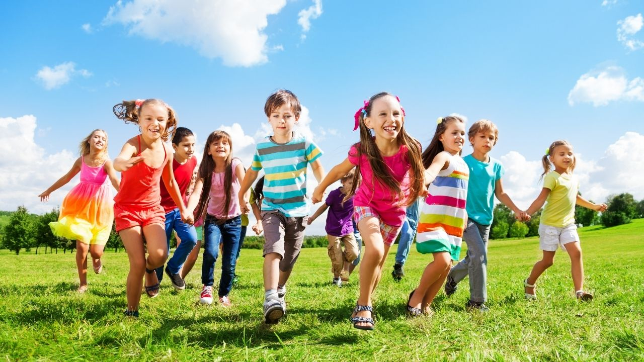 children running enjoying summer - featured image for the post on What Size is After 5T