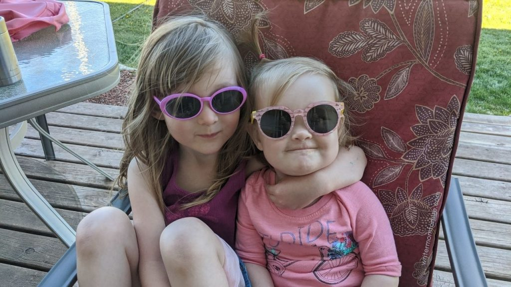young girls wearing their sunglasses