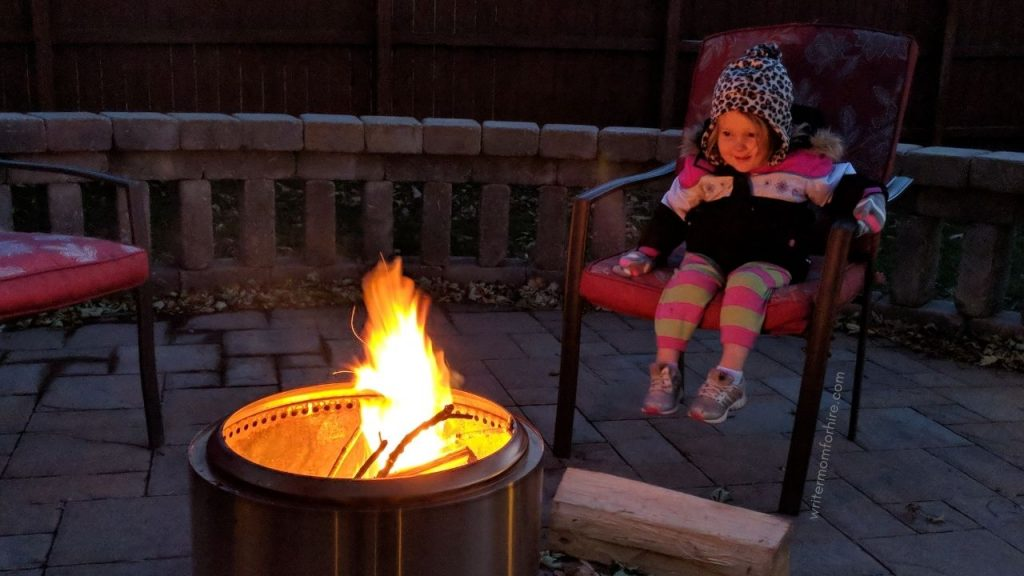 toddler sitting by the solo stove bonfire pit