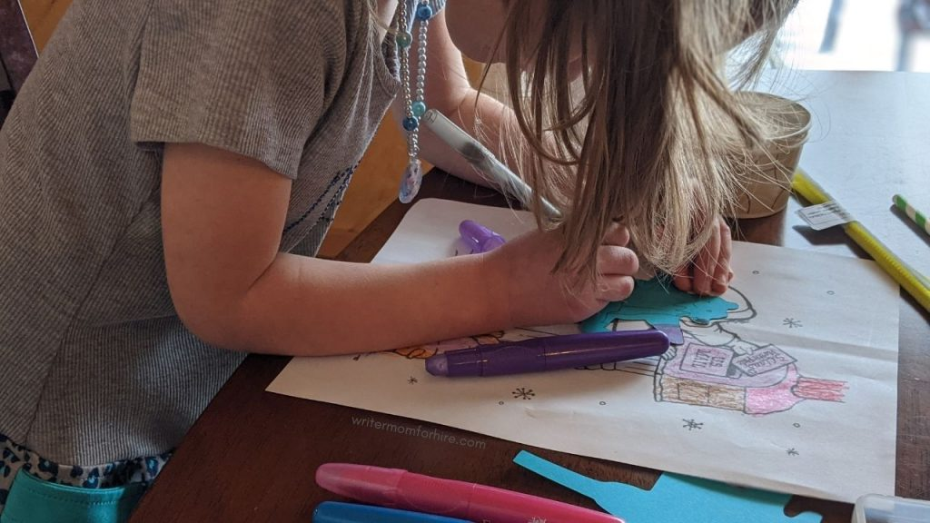 older child crafting with art and craft supplies