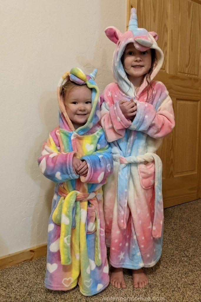 girls wearing unicorn robes